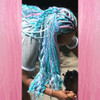 Jawaya wearing Glow Pastel neon box braid, glow in the dark braiding hair, high heat kk in Light Pink,  and kk jumbo braid in Periwinkle and Sky Blue