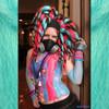 Customer Glow Wurm wearing dreads made from Sky Blue, Neon Magenta, and 1 Black kk jumbo braid