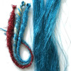 Tinsel hair in action! The dreads are made from Red tinsel, Light Gold kanekalon with Turquoise tinsel, and Turquoise. The color left loose on the right is Turquoise.