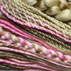 Handmade dreads, braids, and twists in Pink, Pastel Pink, and various shades of blond
