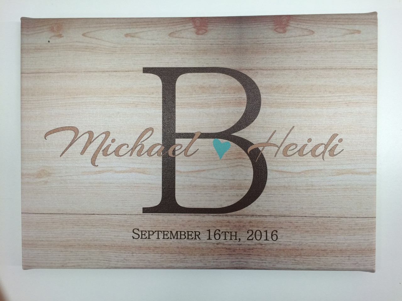 woodgrain canvas print monogram letter with couple s name