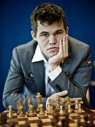 magnus-carlsen-image-with-championship-chess-set.jpg
