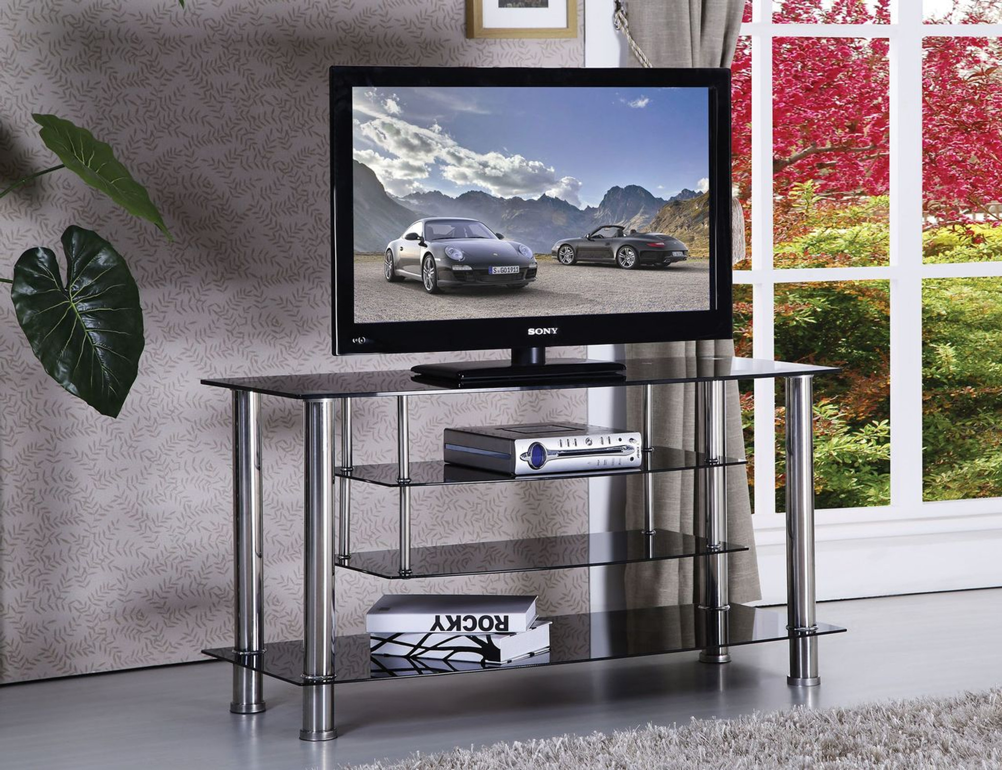 The CHROME GLASS TV STAND WITH 4 SHELVES