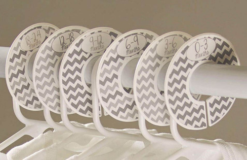 Gray chevron closet dividers separating baby clothing hangers