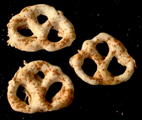 Double dipped sugar free white chocolate pretzels dusted in pumpkin spice
