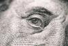 close-up of a 20-dollar bill and Benjamin Franklin's face