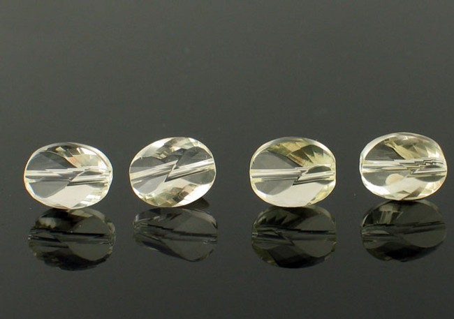10 Count 10x6mm Clear Lemon Topaz Twisted Oval (Sale)