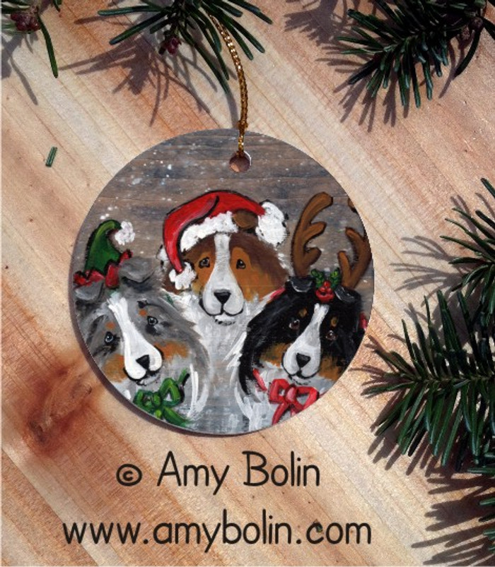 CERAMIC ORNAMENT · CHRISTMAS BUDDIES · BLUE MERLE, SABLE, TRI COLOR SHELTIE · AMY BOLIN