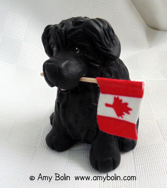 """Love of Country"" Sculpture · Black Newfoundland Dog comes with American & Canadian Flags · Amy Bolin"
