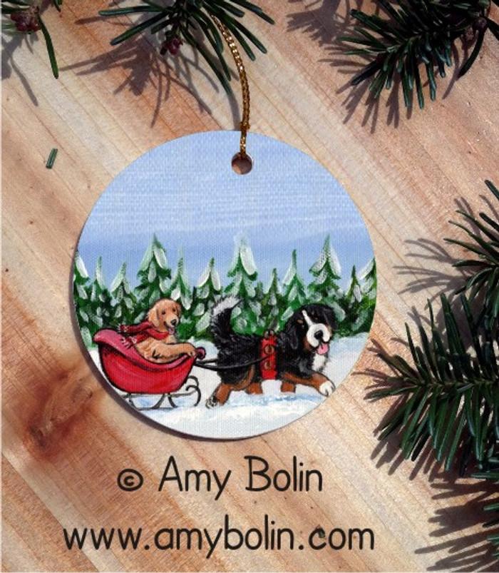 CERAMIC ORNAMENT · A WINTRY RIDE · BERNESE MOUNTAIN DOG & GOLDEN RETRIEVER · AMY BOLIN