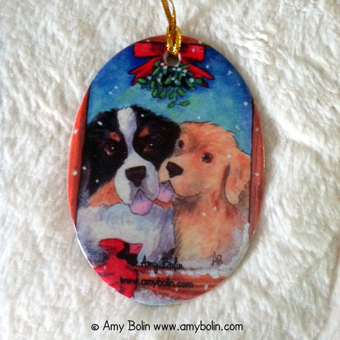 OVAL SHAPED CERAMIC ORNAMENT · UNDER THE MISTLETOE · BERNESE MOUNTAIN DOG & GOLDEN RETRIEVER · AMY BOLIN