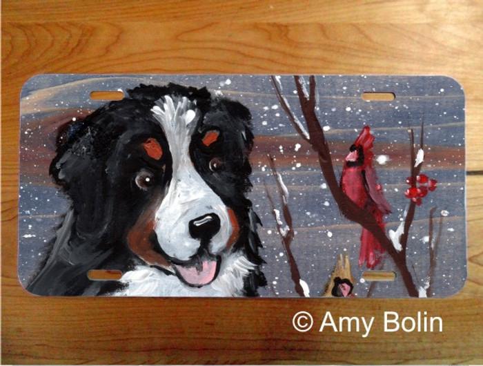 LICENSE PLATE · WINTER BUDDIES · BERNESE MOUNTAIN DOG AND CARDINAL · AMY BOLIN