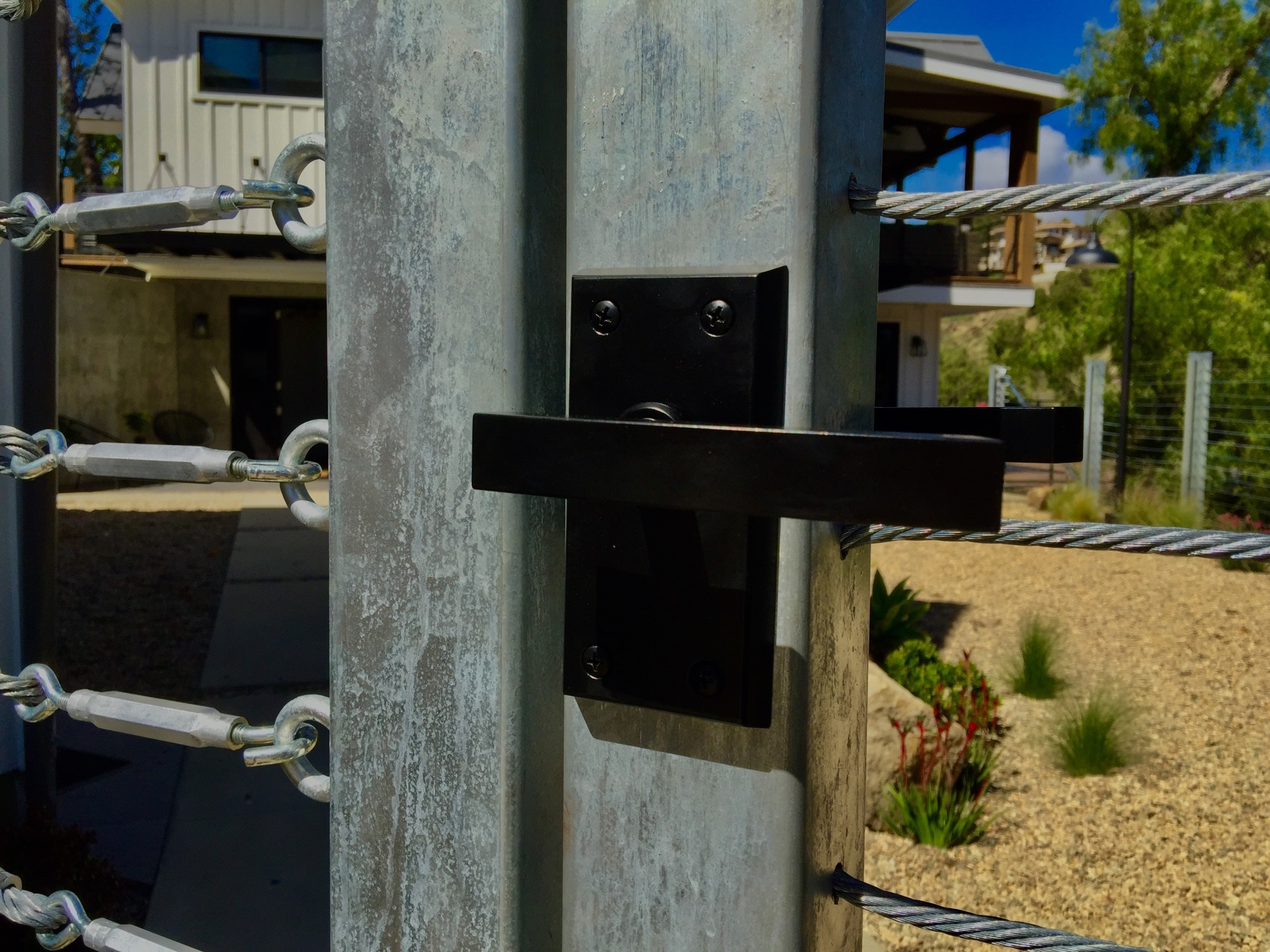 nero-contemporary-gate-latch-on-stainless-gate-at-contemporary-farmhouse.jpg