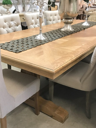 Parquet Trestle Dining Table on display