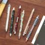Unique pattern knock retractable pen