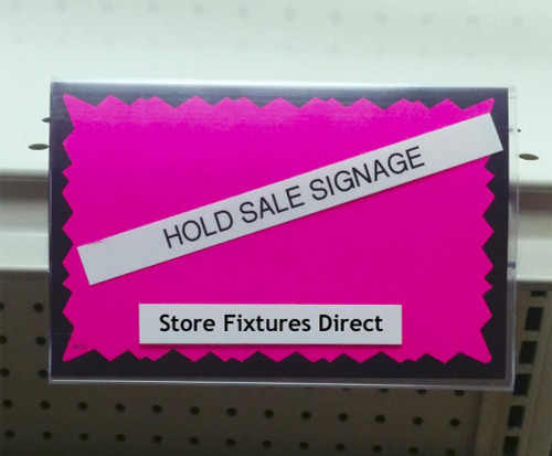 Insert these sign holders into your gondola shelving ticket channel for a simple way hold up signs.