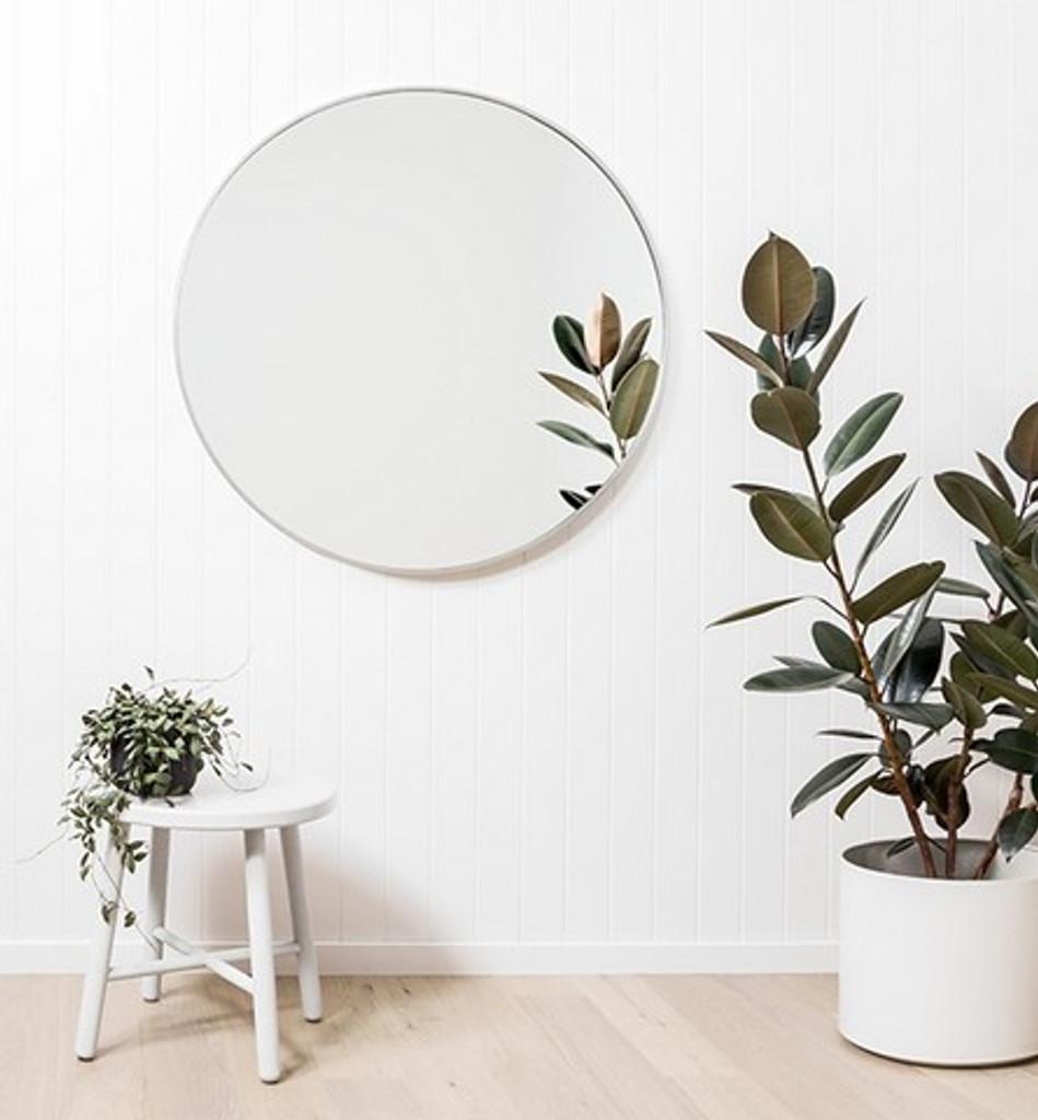 Modern Round Silver Mirror, in situ