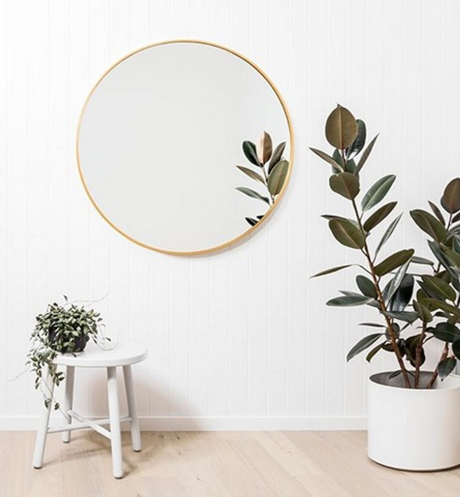 Modern Round Brass Mirror, in a room