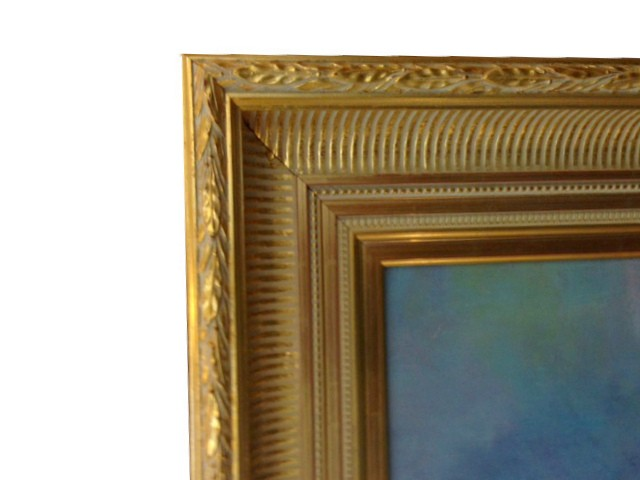Detail of a hand water gilded frame