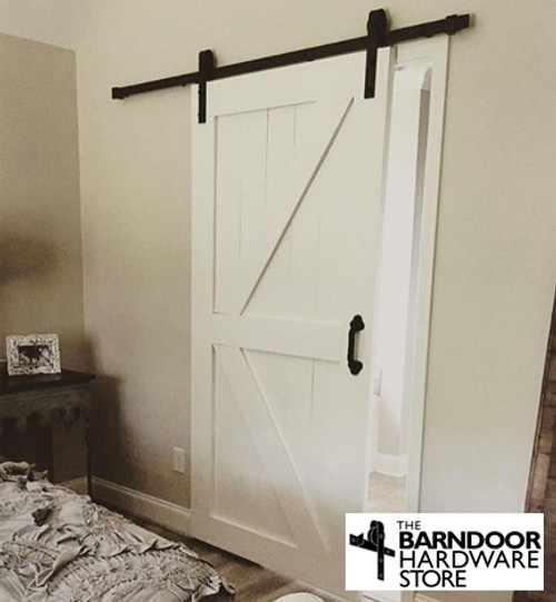 "British Brace Barn Door - painted white. Photo also shows our Antique Style 9"" door pull."