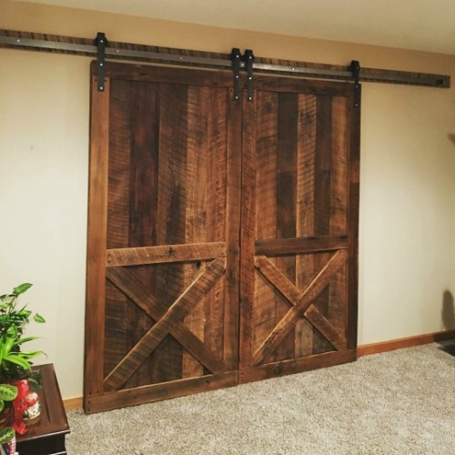 Double reclaimed barn doors with hardware.