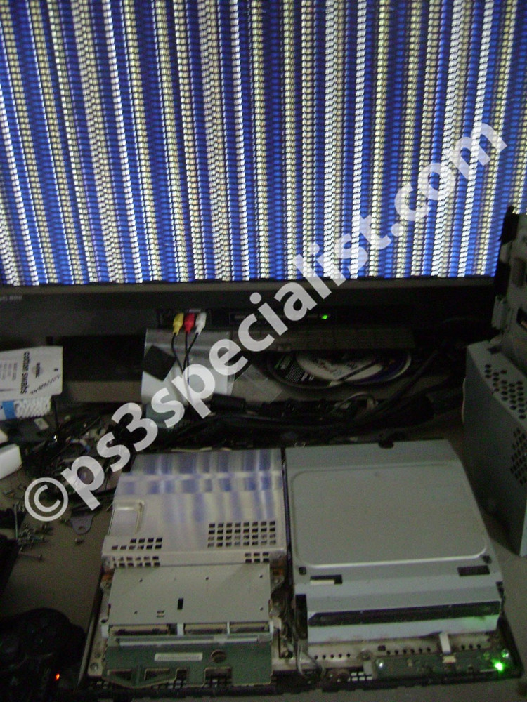 The console connected to a TV and ready for disassembly