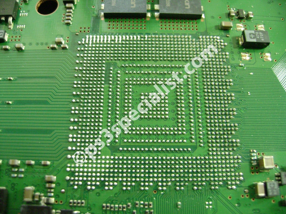The motherboard with the old solder ready to be cleaned