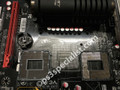 the motherboard with both the damaged and the new sockets