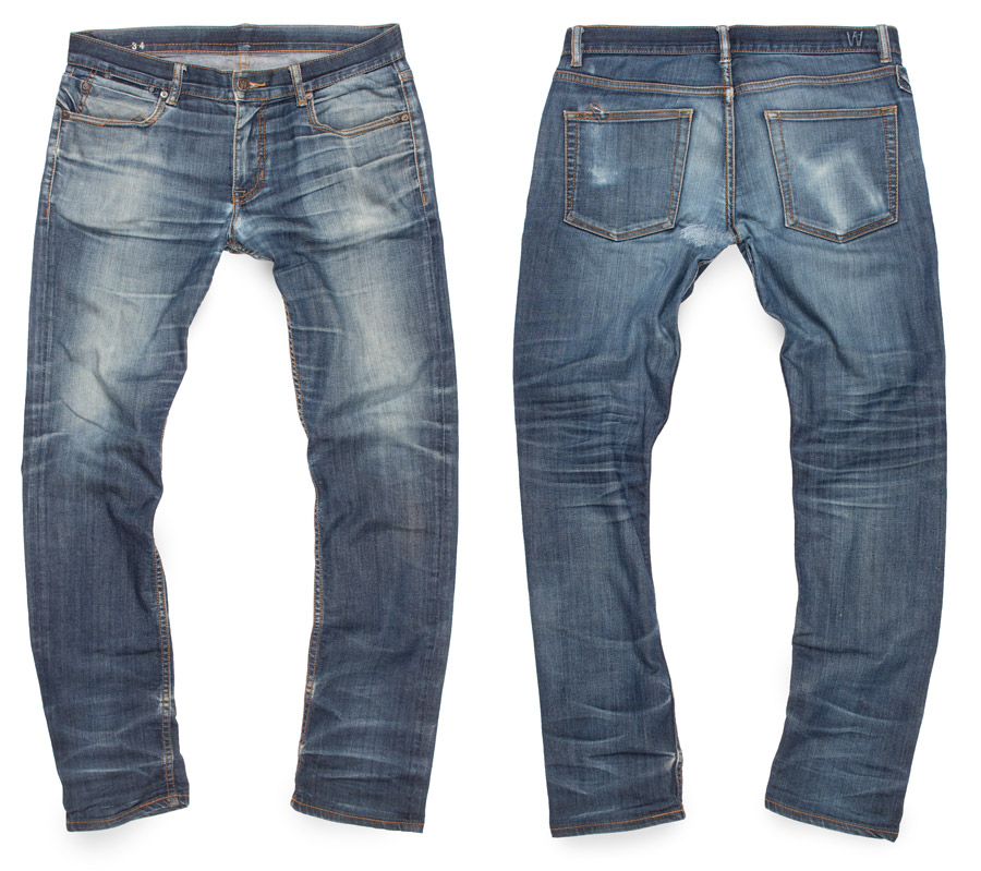 raw denim jeans aged and faded to light blue distressed color