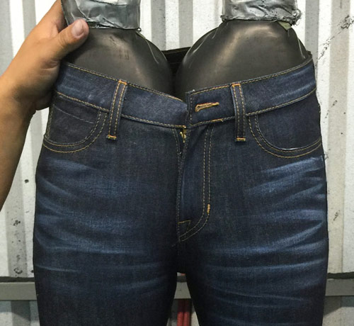whiskers are added to jeans by hand sanding in denim manufacturing