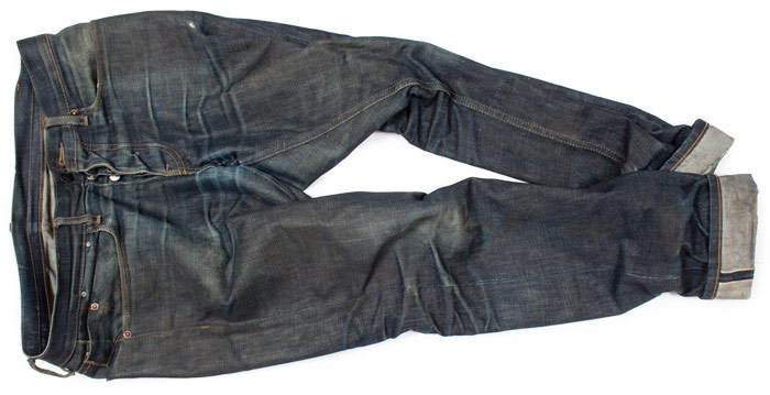 example shows what are whiskers on jeans aged from raw denim