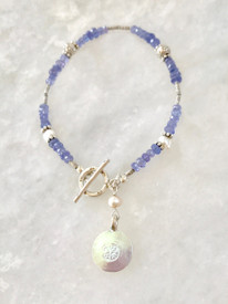 Nature Charm on a simple strand of pearls and tanzanite