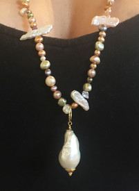 The pearl pendants are all unique- no two will be the same....