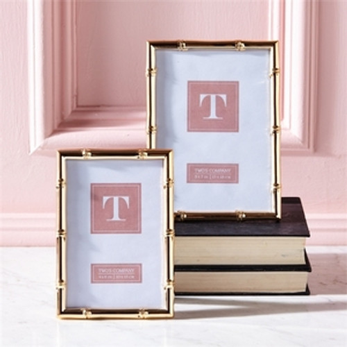 https://d3d71ba2asa5oz.cloudfront.net/12002466/images/51446-twos-company-rose-gold-frames__04356.jpg