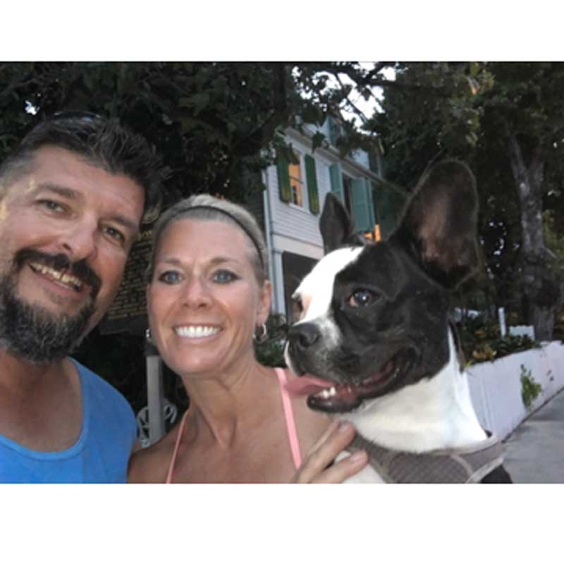 French Bulldog with smiling family