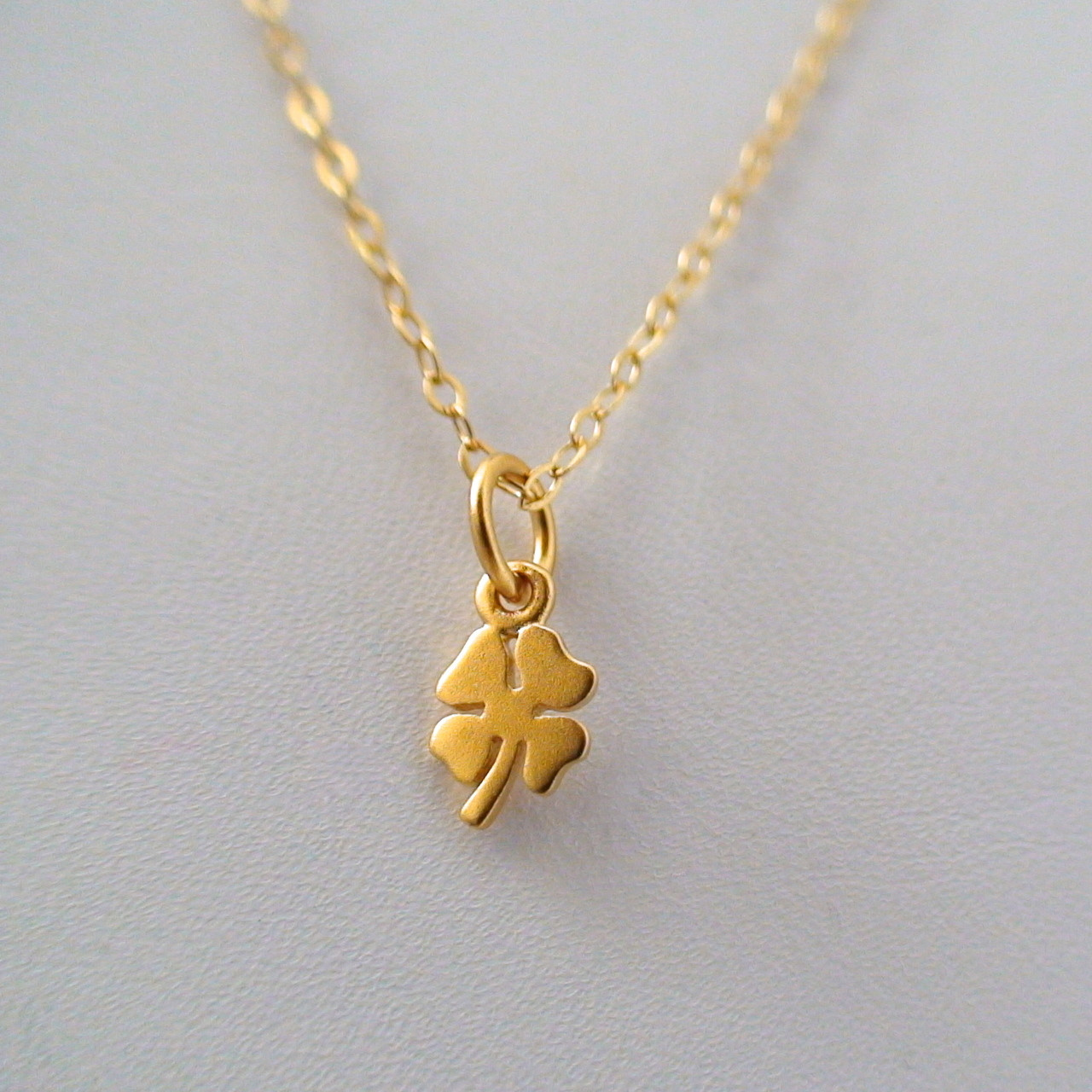 Tiny four leaf clover necklace 24k gold plated sterling aloadofball Choice Image