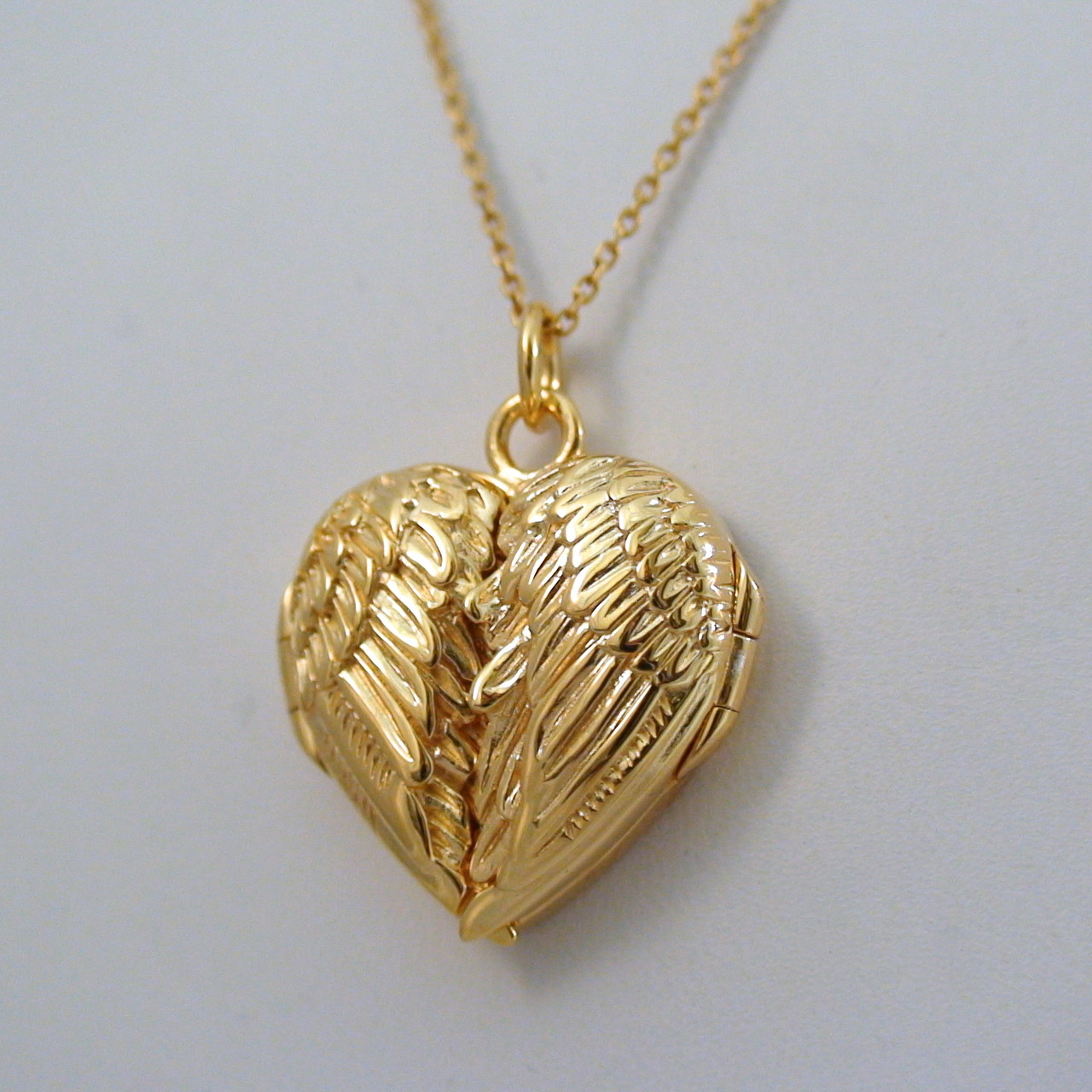 Angel wing locket necklace 14k gold plate sterling silver gold angel wing locket necklace in sterling silver 14k gold plate aloadofball Images