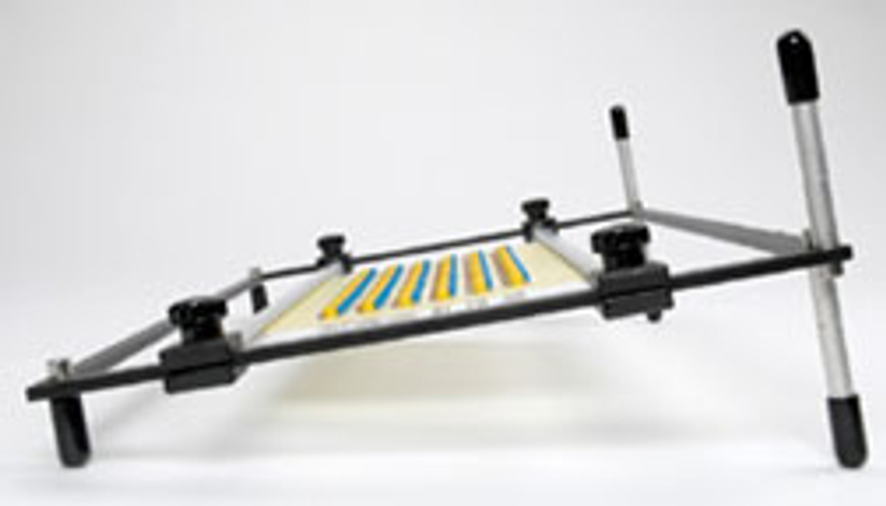 PC Board Holder with spring loaded rails for fast loading  and soldering of circuit boards.