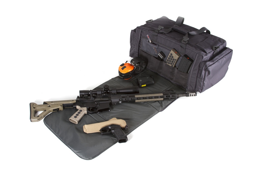The padded mat on the back of the bag hides storage areas for cleaning kits and magazines and can be removed for use as a range or cleaning mat.