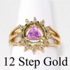 Style #775-7, 14k Gold, AA Symbol Ring with a Circle of 12 Small 2 pt. Clear CZ's and a 5X5mm CZ Triangle in Purple Amethyst in the Center