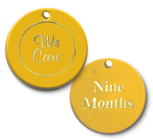 yellow nine months we care plastic recovery coin.