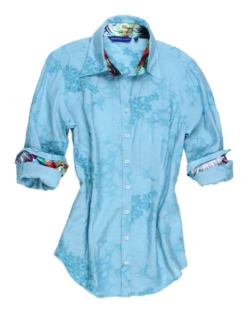 """Elegant is the only way to describe this great shirt!   Beautiful blue on blue embroidered  fabric of 100% Viscose imported European fabric.   It is so very complimented by the colorful small print on the collar stand and rolled sleeves.   The hem line is finished off with a double zig-zag stitching to complete this most """"in fashion"""" look.   It goes with so much and take you anywhere day or night.  100% Viscose"""