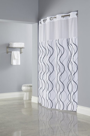 "The Waves Hookless shower curtain features a white polyester fabric with a two-tone printed wave pattern in gray and black and a translucent fabric window. 100% Polyester fabric with coordinating sheer fabric window Two piece set including replaceable Snap-in Liner Water repellent snap-in liner with magnets resists soap scum and minimizes mold and mildew Chrome raised Flex-On rings allow 10 second installation without removing the shower rod 71 by 77 inches Available in white  Call 855-468-3528 or click here to email us about large quantity purchases.   Available in different styles to complement any decor, the Hookless® shower curtain is not only handsome - it's also extra durable because it's made for hotels. It installs in seconds and operates smoothly without tugging or snagging. This curtain ""stacks"" beautifully for a neat appearance when pushed to the side.  The Waves Hookless® shower curtain with ""It's A Snap""™ liner works with any shower rod, but combine it with The Arc ™ curved shower rod for an elegant upgrade."