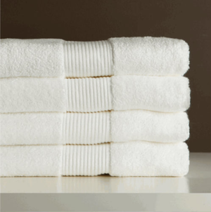 Our attractive Green Earth® towels are incredibly soft, absorbent and durable – more so than comparable hospitality towels. Plus they're better for the environment! What's the secret? They're made with super-fine Extra Long Staple cotton that features a higher fiber strength than regular cotton, resulting in a bulkier yarn and more open loop structure. And because the open loop structure has more surface area, it absorbs 10 to 12 times its weight in water and dries 10 to 20% faster than regular cotton towels.  Manufactured to reduce impact on the environment in a state-of-the-art, agri-waste powered, zero discharge facility incorporating control-union certified, sustainable eco-friendly dyes and chemicals. Available in classic white.  - High fiber strength Extra Long Staple cotton - Wonderfully soft and bulky, yet light - Exceptional durability - Superior absorption: absorbs 10-12 times its weight in water - Faster drying: 10 to 20% faster than regular cotton towels - Costs less to launder (uses less water and detergent; dries faster) - Eco-friendly manufacturing - Available only in classic white  Bath Towel: 27x54 Hand Towel: 20x32 Washcloth: 13x13 Bath Mat: 20x35 Bath Sheet: 33x70 Oversize Bath:30x56 Call 855-468-3528 or click here to email us about large quantity purchases.