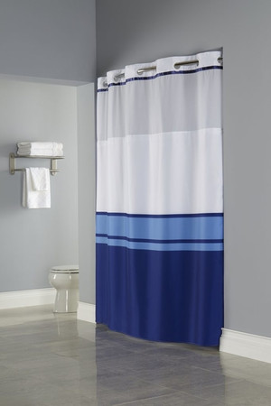 "Available in different styles to complement any decor, the Brooks Window  Hookless® shower curtain is not only handsome - it's also extra durable because it's made for hotels. The Brooks Window  Hookless® shower curtain installs in seconds and operates smoothly without tugging or snagging. The Brooks Window  Hookless® shower curtain curtain ""stacks"" beautifully for a neat appearance when pushed to the side. The Brooks Window Hookless® shower curtain with ""It's A Snap""™ liner works with any shower rod, but combine it with The Arc ™ for an elegant upgrade. The Brooks Window Hookless® combines a blue color block pattern with a coordinating satin trim above the sheer voile window.  Two piece set including Snap-in Liner Combines a blue color block pattern with a coordinating satin trim  Polyester cloth fabric with sheer, matching color poly-voile window  Water repellent snap-in liner resists soap scum and minimizes mold and mildew Matching flat Flex-On® rings Washable and dryable 71 by 77 inches Call 855-468-3528 or click here to email us about large quantity purchases."
