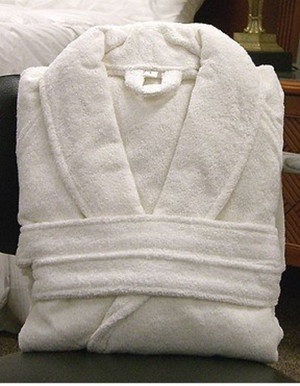 Snuggle into comfort with our premier Rivolta Carmignani luxury robe. Made of 100% cotton, this heavy, soft terry cloth robe features a shawl collar, two pockets, cuffed sleeves, a belt with double loops and a hanger loop. Machine washable and dryable. One size fits most; available in classic white.   Used in resorts throughout the world, Rivolta Carmignani luxury linens have been made by the Rivolta family company in Macherio, Italy since 1867.