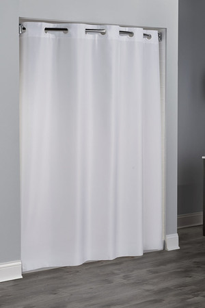 "Extra Long Length Available   This classic, pattern-free shower curtain will enhance any decor. 100% Polyester fabric Weighted corner magnets Color matched Flex-On rings allow 10 second installation without removing the shower rod 71 by 74 or 71 by 80 inches Available in white Call 855-468-3528 or click here to email us about large quantity purchases.   Available in different styles to complement any decor, the Hookless® shower curtain is not only handsome - it's also extra durable because it's made for hotels. It installs in seconds and operates smoothly without tugging or snagging. This curtain ""stacks"" beautifully for a neat appearance when pushed to the side.   The Plainweave Hookless® shower curtain works with any shower rod, but combine it with The Arc ™ curved shower rod for an elegant upgrade."