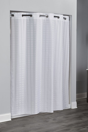 "Available in different styles to complement any decor, the Litchfield Hookless® shower curtain is not only handsome - it's also extra durable because it's made for hotels. It installs in seconds and operates smoothly without tugging or snagging. This curtain ""stacks"" beautifully for a neat appearance when pushed to the side. The Litchfield Hookless® shower curtain works with any shower rod, but combine it with The Arc ™ for an elegant upgrade. The top selling Litchfield Hookless® shower curtain creates a visual effect of multiple rectangles.   100% polyester Water repellent Built-in magnets 71 x 74 inches Available in white & beige  Call 855-468-3528 or click here to email us about large quantity purchases."