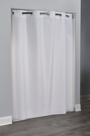 "Available in different styles to complement any decor, the Hookless® shower curtain is not only handsome - it's also extra durable because it's made for hotels. It installs in seconds and operates smoothly without tugging or snagging. This curtain ""stacks"" beautifully for a neat appearance when pushed to the side. The Hookless® shower curtain works with any shower rod, but combine it with The Arc ™ for an elegant upgrade.  100% polyester Water repellent Built-in magnets Matching color rings Anti-microbial 71 x 74 inches Available in white & beige"