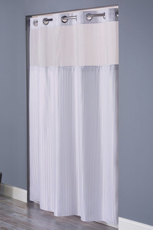 """Available in different styles to complement any decor, the Double H Hookless® shower curtain is not only handsome - it's also extra durable because it's made for hotels. The Double H Hookless® shower curtain installs in seconds and operates smoothly without tugging or snagging.the Double H Hookless® shower curtain """"stacks"""" beautifully for a neat appearance when pushed to the side. The Double H Hookless® shower curtain with """"It's A Snap""""™ liner works with any shower rod, but combine it with The Arc ™ for an elegant upgrade. The Double H Hookless® shower curtain, is a standard design for many of the leading hotels and has a 1⁄2"""" herringbone weave constructed of 100% polyester. Highly Machine Washable.     Tone-on-tone chevron pattern polyester cloth with sheer cloth panel and snap-in liner Water repellent Chrome plated rings Heavy duty snaps with flap to prevent leakage Highly Machine Washable Treated to resist soap scum and minimize mold and mildew Available in white & beige only 71"""" x 77""""   Call 855-468-3528 or click here to email us about large quantity purchases.     (Note: The digital images we display have the most accurate color possible. However, due to differences in computer monitors, we cannot be responsible for variations in color between the actual product and your screen.)"""